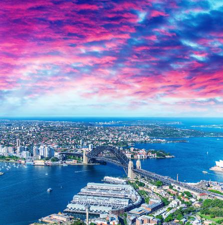Helicopter view of Sydney Harbor Bridge and city skyline, Australia.