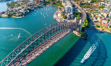 Helicopter view of Sydney Harbor Bridge and Lavender Bay, New South Wales, Australia.