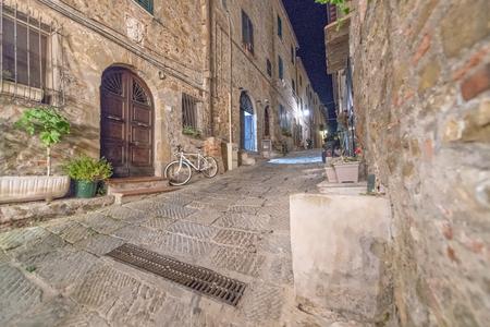 Medieval town of Castiglione della Pescaia at night, Tuscany, Italy.