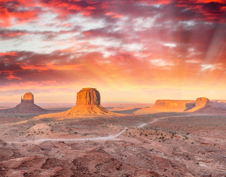 Rocks and buttes of Monument Valley at sunset.