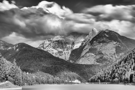 Long exposure of alpin lake in late afternoon. 스톡 콘텐츠
