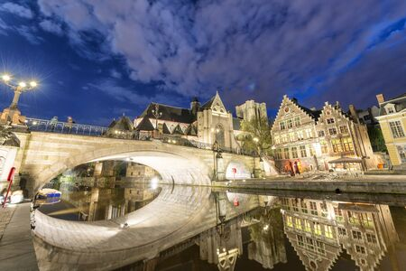 Night city view along the canal, Gent, Belgium. Stok Fotoğraf