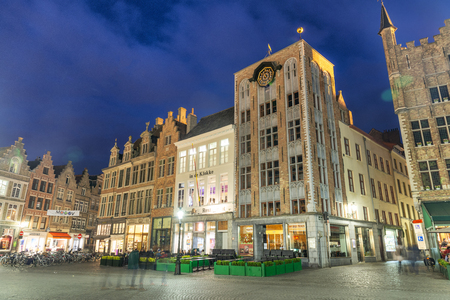 BRUGES, BELGIUM - MARCH 2015: Famous buildings along the main square at night. Bruges is a famous city in Belgium. Editorial