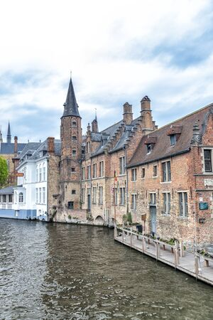Bruges city buildings along the canal, Belgium.