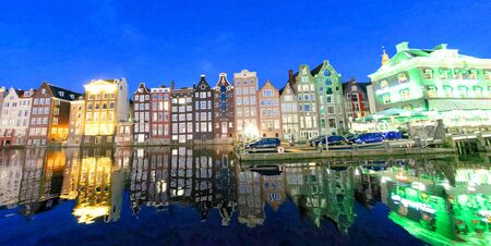 Night view of canal and classic buildings, Amsterdam, The Netherlands.