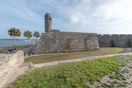 ST AUGUSTINE, FL - APRIL 2018: San Marcos Castle with tourists. This is a major city attraction.