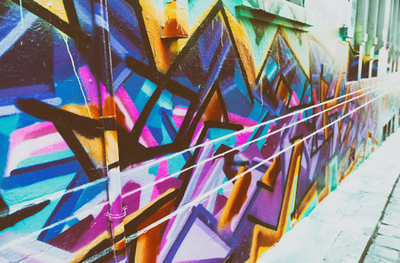MELBOURNE, AUSTRALIA, - OCTOBER 2015: Colorful street art by unidentified artist in Melbourne laneway.