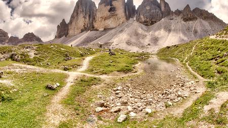 Three Peaks of Lavaredo in summer season, Italian Dolomites. Фото со стока
