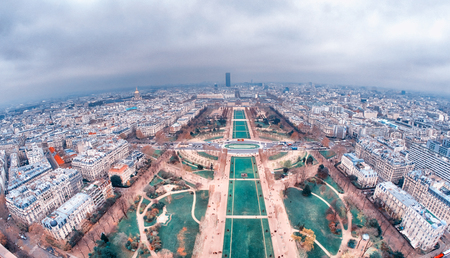 Wide angle aerial view of Paris skyline as seen from top of Eiffel Tower.