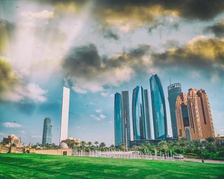Abu Dhabi modern skyline from Emirates Palace Gardens on a sunny day, UAE