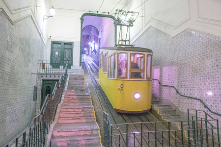 LISBON - OCTOBER 31, 2018: People inside Ascensor da Bica at night. Lisbon attracts 3 million tourists annually. 写真素材
