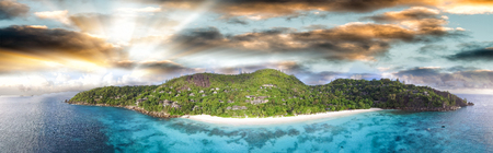 Sunset panoramic aerial view of Petit Anse in Mahe, Seychelles