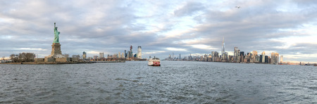 Statue of Liberty, Jersey City and Manhattan from Cruise Ship, panoramic view at sunset, New York City. 版權商用圖片