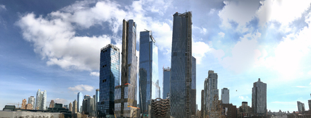 Panoramic view of Manhattan skyline and Hudson Yards on a winter day. The city attracts 50 million people annually. 写真素材