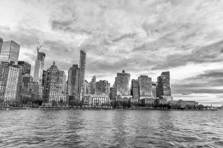 Sunset Manhattan skyline from a cruise ship, New York City.