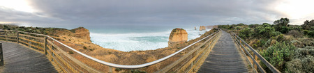 Panoramic aerial view of Twelve Apostles promenade on a cloudy winter sunrise, Australia