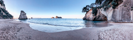 Cathedral Cove panoramic view. Beach and coastline at sunset, Coromandel, New Zealand.