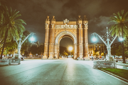 BARCELONA - MAY 10, 2018: Triumph Arc Square at night with tourists. The city attracts 15 million people annually.