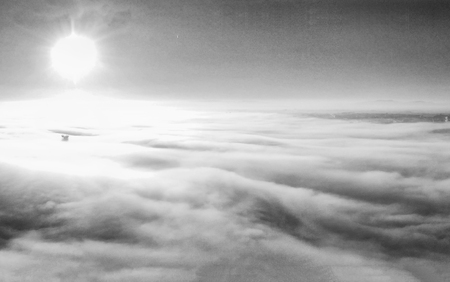 Panoramic aerial view of countryside scenario surrounded by fog, view from drone above the clouds. Imagens