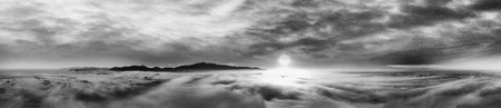 Panoramic aerial view of countryside scenario surrounded by fog, view from drone above the clouds at sunset. Imagens - 118512528