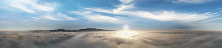 Panoramic aerial view of countryside scenario surrounded by fog, view from drone above the clouds. Imagens - 118513117