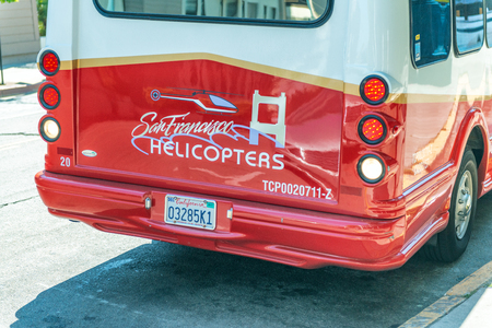 SAN FRANCISCO, CA - AUGUST 7, 2017: San Francisco Helicopter Ad on a bus. It is a famous tourist attraction.