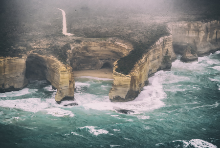 Aerial view of natural rock formations along Great Ocean Road on a stormy day, Australia. 版權商用圖片