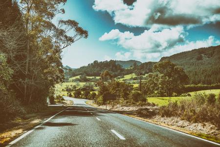 Beautiful road across countryside hills.