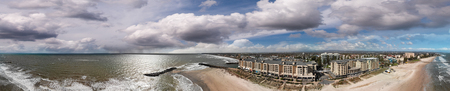 Glenelg, Australia. Panoramic aerial view of cityscape and coastline on a sunny day.