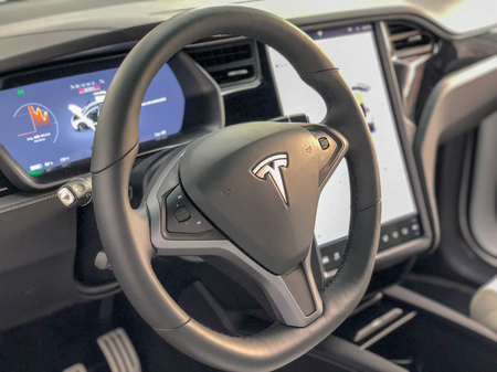 NEW YORK CITY - DECEMBER 1 2018: Interior of Tesla car with steering wheel and big screen. Tesla is a fast growing automobile company Editorial
