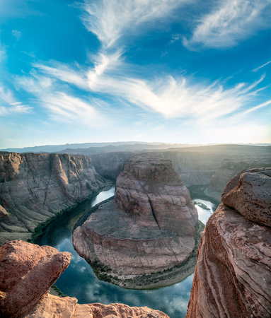 Horseshoe Bend and Colorado River at dusk, Arizona, USA. Backlit scene.