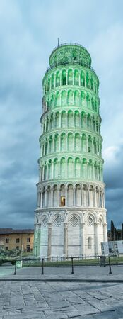 Pisa Tower for St Patricks Day illuminated by green lights.