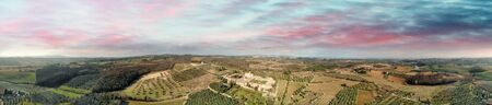 Amazing panoramic aerial view of Pontignano Charterhouse near Siena at dusk, Tuscany.