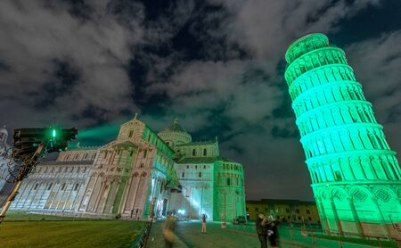 Green light illuminating Pisa Leaning Tower for St Patricks day celebrations. Stock Photo