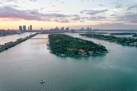 Palm Island and Hibiscus Island in Miami. Aerial view from helicopter at sunset.