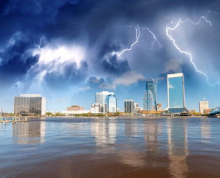 Downtown Jacksonville and St Johns River from Southbank Riverwalk. Beautiful water reflections during a storm. Stock fotó