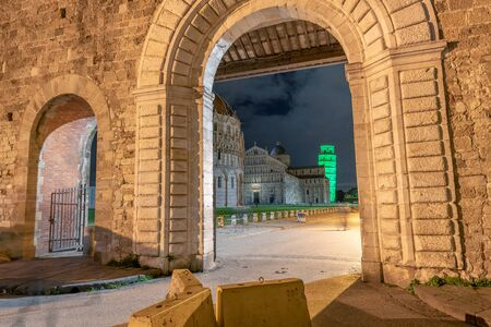 Pisa Tower in Square of Miracles for St Patrick's Day Celebrations. View from outside city walls. Stock Photo - 131707047