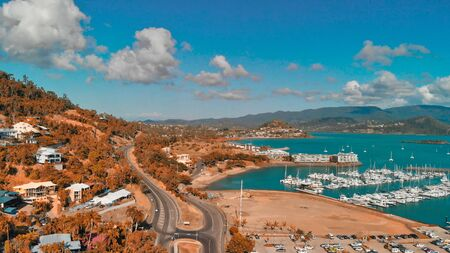 Panoramic aerial view of Airlie Beach skyline and Marina, Australia.