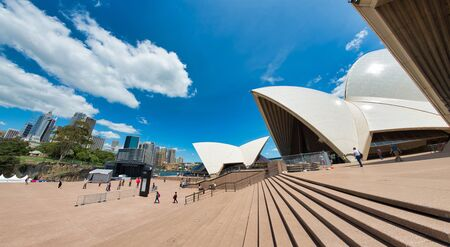 SYDNEY - OCTOBER 2015: Panoramic view of Sydney Opera House on a sunny day. The city attracts 20 million people annually. Imagens
