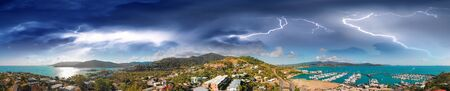 Airlie Beach skyline aerial view during a storm, Queensland coastline.