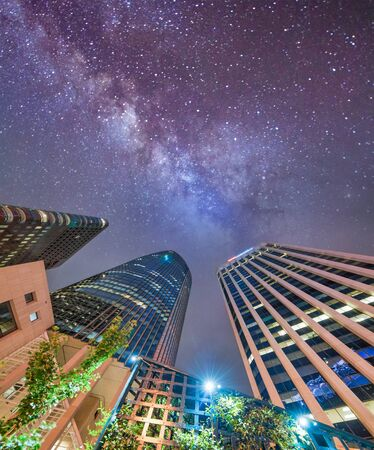 San Francisco skyscrapers on a starry night, skyward view.