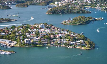 Aerial view of Sydney outskirts with water and homes.