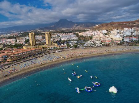 Aerial view of Los Cristianos coastline in Tenerife from drone.
