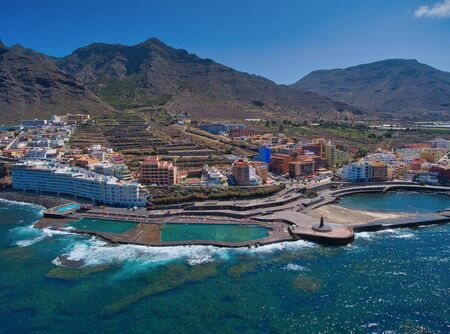 Aerial view of Puerto de la Cruz coastline in Tenerife from drone. Stock fotó