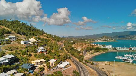 Panoramic aerial view of Airlie Beach skyline at dusk, Queensland.