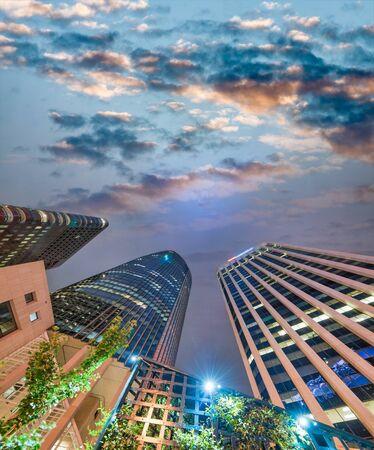 San Francisco buildings at night, skyward view.