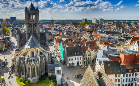 GENT, BELGIUM - MARCH 2015: Tourists visit ancient medieval city. Gent attracts more than 1 million people annually. Editorial