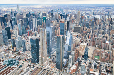 New York City from helicopter point of view. Midtown Manhattan and Hudson Yards on a cloudy day, USA