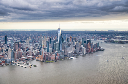 New York City from helicopter point of view. Downtown Manhattan, Jersey City and Hudson River on a cloudy day. Stock Photo