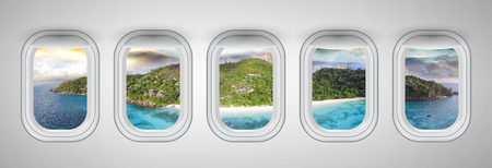 Seychelles at sunset as seen through five aircraft windows. Holiday and travel concept.